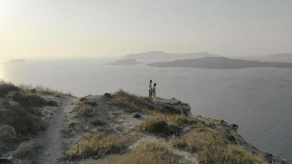 drone sunset santorini engagement wedding videographer