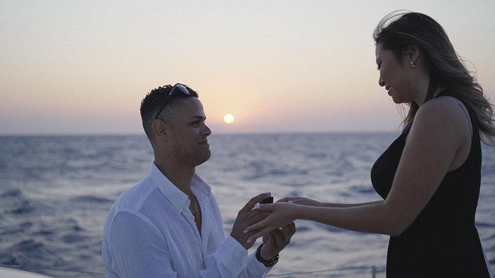 she said yes in santorini engagement boat sunrise sunset