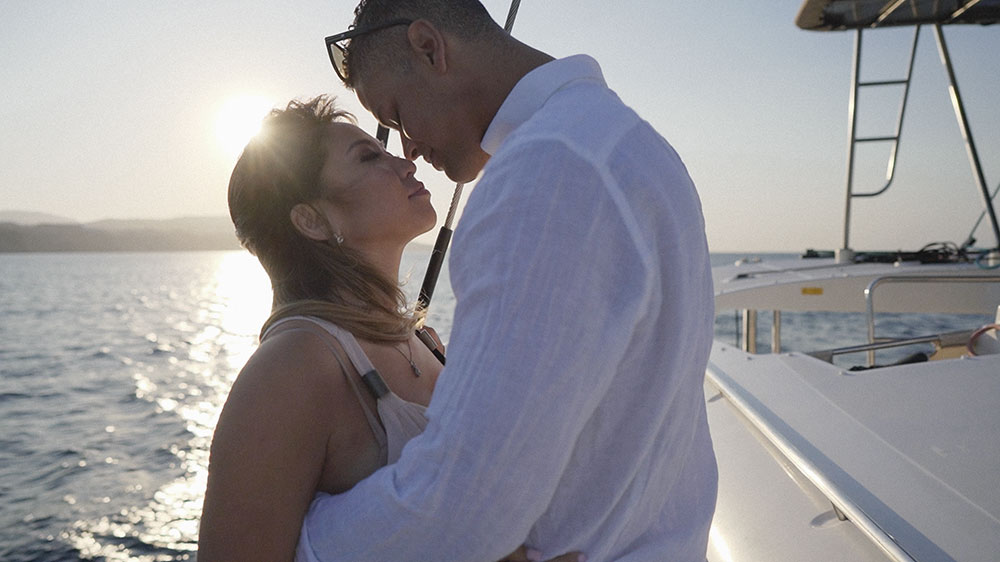 santorini engagement catamaran boat wedding videographer